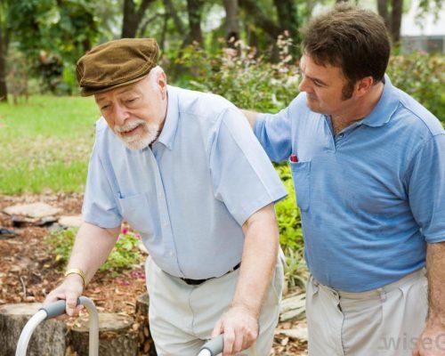 man-helping-elderly-man-walk